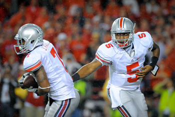Braxton Miller (right) had the Ohio State offense reeling until he went down with an ankle injury.