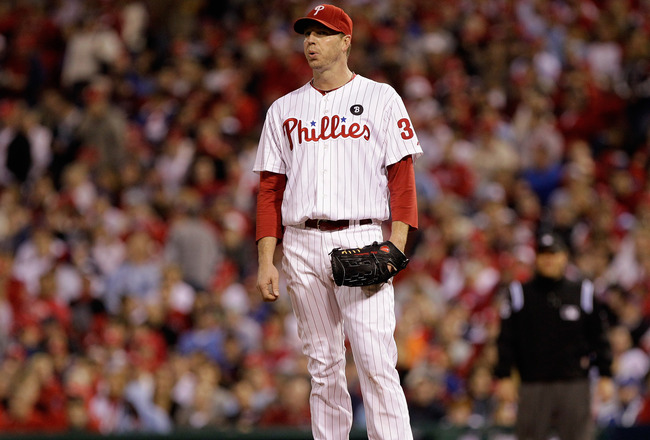 PHILADELPHIA, PA - OCTOBER 07:  Roy Halladay #34 of the Philadelphia Phillies looks on as he pitches against the St. Louis Cardinals during Game Five of the National League Divisional Series at Citizens Bank Park on October 7, 2011 in Philadelphia, Pennsy