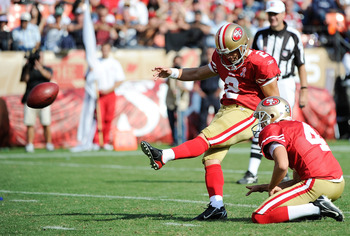 David Akers drills a field goal for the Niners