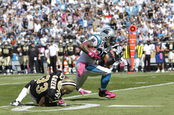 Steve Smith (89) breaks Jabari Greer's tackle on his way to a 54-yard touchdown reception.