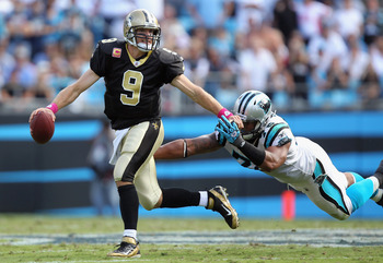 Panthers' Defensive End Greg Hardy pressures Saints quarterback Drew Brees (9) in New Orleans' 30-27 victory in Charlotte, NC.