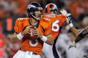 DENVER, CO - SEPTEMBER 12:  Quarterback Kyle Orton #8 of the Denver Broncos drops back to pass against the Oakland Raiders in the first half at Sports Authority Field at Mile High on September 12, 2011 in Denver, Colorado.  (Photo by Doug Pensinger/Getty