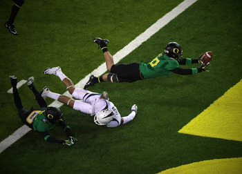 John Boyett drops a sure interception.  Photo by Joel Conrad Bechtolt
