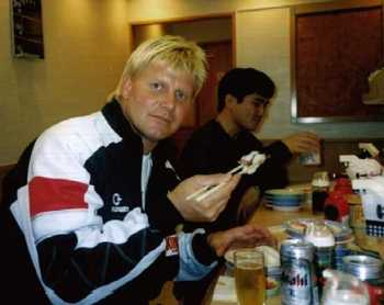 John Laurinaitis enjoying a brewski and sushi (Photo by Masanori Horie)