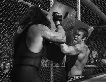 Randy Orton battles The Undertaker in SATAN'S STRUCTURE. (Photo by WWE)