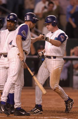 28 Oct 2001: Matt Williams #9 of the Arizona Diamondbacks is congratulated by teammate Mark Grace #17 after hitting a three run home run in the seventh inning against the New York Yankees during game two of the Major League Baseball World Series at Bank O