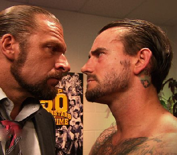 Cm-punk-vs-triple-h_display_image