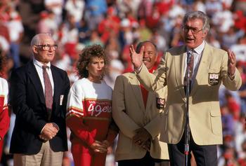 SAN FRANCISCO - NOVEMBER 18:  (L-R) 49ers Hall of Famers Y.A. Tittle, Joe Perry stand next to Bob St. Clair who speaks to the fans during a game between the San Francisco 49ers and Tampa Bay Buccaneers at Candlestick Park on November 18, 1990 in San Franc