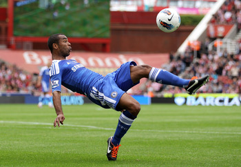 STOKE ON TRENT, ENGLAND - AUGUST 14:  Ashley Cole of Chelsea plays an overhead kick during the Barclays Premier League match between Stoke City and Chelsea at the Britannia Stadium on August 14, 2011 in Stoke on Trent, England.  (Photo by Clive Brunskill/