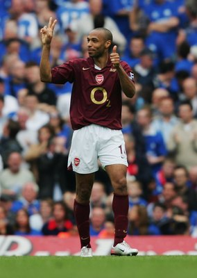 Henry celebrating his first two out of three at the final game at Highbury.