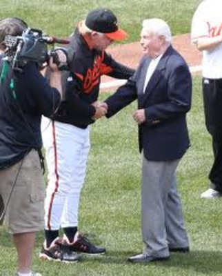 Current O's Manager Buck Showalter shaking the hand of O's legendary skipper Earl Weaver (right)