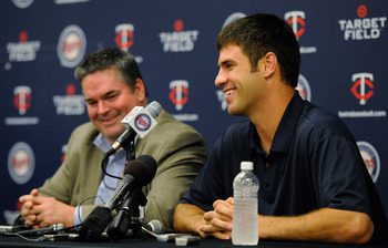 MINNEAPOLIS, MN - JUNE 16: Joe Mauer #7 of the Minnesota Twins and Bill Smith, general manager of the Minnesota Twins speak to the media on June 16, 2011 at Target Field in Minneapolis, Minnesota. (Photo by Hannah Foslien/Getty Images)