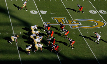 ATLANTA - OCTOBER 09:  The offense of the Georgia Tech Yellow Jackets against the defense of the Virginia Cavaliers at Bobby Dodd Stadium on October 9, 2010 in Atlanta, Georgia.  (Photo by Kevin C. Cox/Getty Images)