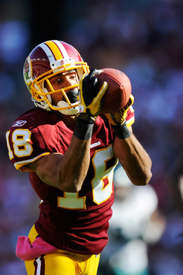 LANDOVER, MD - OCTOBER 16:  Terrence Austin #18 of the Washington Redskins catches a 32 yard pass from John Beck #12 of the Washington Redskins in the fourth quarter against Philadelphia Eagles at FedExField on October 16, 2011 in Landover, Maryland.  (Ph