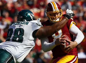 LANDOVER, MD - OCTOBER 16: Quarterback Rex Grossman #8 of the Washington Redskins is sacked by defensive tackle Mike Patterson #98 of the Philadelphia Eagles during first half action at FedExField on October 16, 2011 in Landover, Maryland.  (Photo by Win