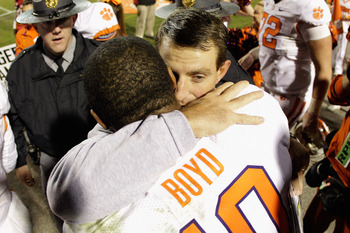 Clemson head coach Dabo Swinney hugs his quarterback, Tajh Boyd, in a win against Maryland.