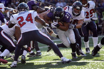 BALTIMORE, MD - OCTOBER 16:  Ray Rice #27 of the Baltimore Ravens runs the ball against Andrew Gardner #66 and Johnathan Joseph #24 of the Houston Texans at M&T Bank Stadium on October 16, 2011 in Baltimore, Maryland.  (Photo by Rob Carr/Getty Images)