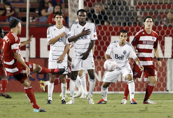 Vancouver attempts to deflect a set piece from FC Dallas's Daniel Hernandez.