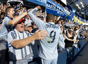 Sporting Kansas City's Teal Bunbury embraces his faithful followers.