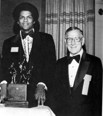 Marques Johnson with John Wooden. Photo Credit: insidesocal.com