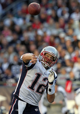 FOXBORO, MA - OCTOBER 16:   Tom Brady #12 of the New England Patriots throws during a game against the New England Patriots in the second half at Gillette Stadium on October 16, 2011 in Foxboro, Massachusetts. (Photo by Jim Rogash/Getty Images)