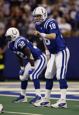 INDIANAPOLIS - DECEMBER14:  Quarterback Peyton Manning #18 lines up next to Edgerrin James #32 of the Indianapolis Colts during the game against the Atlanta Falcons on December 14, 2003 at the RCA Dome in Indianapolis, Indiana. The Colts defeated the Falc