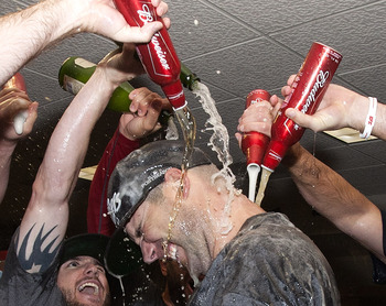 HOUSTON - SEPTEMBER 28:  Pitcher Chris Carpenter of the St. Louis Cardinals is showered with beer as they celebrate winning the National League wild card at Minute Maid Park on September 28, 2011 in Houston, Texas.  (Photo by Bob Levey/Getty Images)