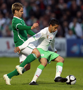 DUBLIN, IRELAND - MAY 28:  Sean St. Ledger of Republic of Ireland tries to tackle Riad Boudebouz of Algeria during the International Friendly match between Republic of Ireland and Algeria at the Royal Dublin Society Main Arena on May 28, 2010 in Dublin, I