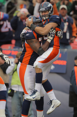 DENVER, CO - OCTOBER 09:  Quarterback Tim Tebow #15 of the Denver Broncos celebrates his third quarter touchdown with Ryan Clady #78 of the Denver Broncos against the San Diego Chargers at Sports Authority Field at Mile High on October 9, 2011 in Denver,