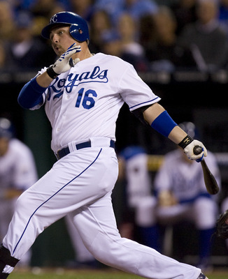 KANSAS CITY, MO - SEPTEMBER 21:   Billy Butler #16 of the Kansas City Royals hits a RBI double in the first inning during a game against the Detroit Tigers at Kauffman Stadium on September 21, 2011 in Kansas City, Missouri. (Photo by Ed Zurga/Getty Images