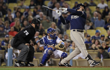 LOS ANGELES, CA - SEPTEMBER 22:  Adrian Gonzalez  #23 of the San Diego Padres hits a single in the fifth inning against the Los Angeles Dodgers at Dodger Stadium on September 22, 2010 in Los Angeles, California.  (Photo by Jeff Gross/Getty Images)