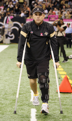 NEW ORLEANS, LA - OCTOBER 23:  New Orleans Saints' head coach Sean Peyton walks the sidline in crutches before hosting the Indianapolis Colts at Mercedes-Benz Superdome on October 23, 2011 in New Orleans, Louisiana.  Peyton was injured last week when a pl