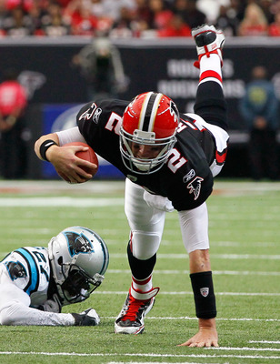 Quarterback Matt Ryan stumbling forward.