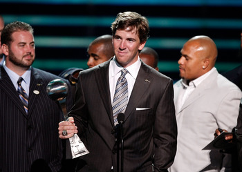 Giants' quarterback Eli Manning following in his older brother's footsteps