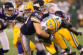 Jared Allen (#69) tackles Packers' runner James Starks (#44) for a loss