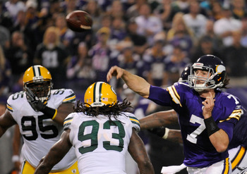 Christian Ponder (#7) throws a pass against the Green Bay Packers