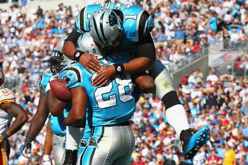Jonathan Stewart and Cam Newton celebrate a score during the Panthers 33-20 victory over the Redskins.