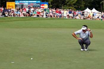 NORTON, MA - SEPTEMBER 04:  Bubba Watson reads a putt on the ninth hole green uring the third round of the Deutsche Bank Championship at TPC Boston on September 4, 2011 in Norton, Massachusetts.  (Photo by Michael Cohen/Getty Images)