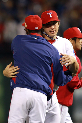 A hug from the skipper was in order, as Derek Holland single-handedly shutdown the potent Cardinals' bats.