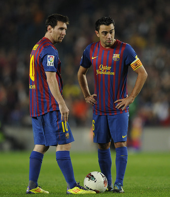 Two of the best footballers in the world - Messi and Xavi - waiting to kick off for Barcelona.