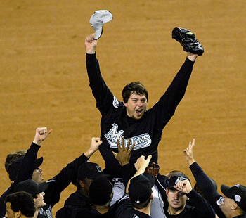 23 year old Josh Beckett is hoisted in celebration by his teammates after shutting out the Yankees to win the 2003 World Series