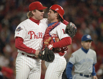 Curt Schilling and catcher Darren Daulton embrace following his game 5 performance.