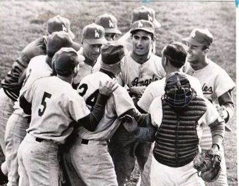Sandy Koufax is mobbed by teammates after winning game 7 of the 1965 World Series