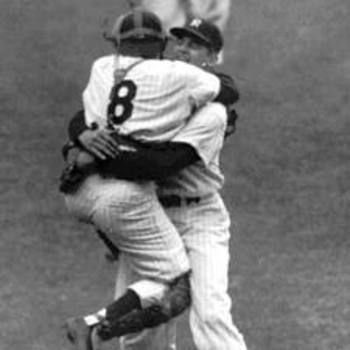 Don Larsen and Yogi Berra embrace in celebration of Larsen's perfection