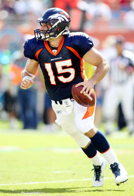 MIAMI GARDENS, FL - OCTOBER 23:  Quarterback Tim Tebow #15 of the Denver Broncos rolls out against the Miami Dolphins at Sun Life Stadium on October 23, 2011 in Miami Gardens, Florida.  (Photo by Marc Serota/Getty Images)