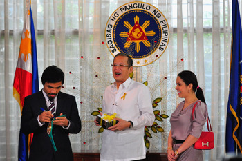 Pacquiao receiving the Presidential Medal of Merit