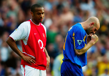 Contrasting emotions: Thierry Henry and Danny Mills