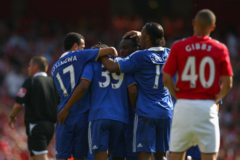 Arsenal old boy Anelka is congratulated by his Chelsea teammates after scoring