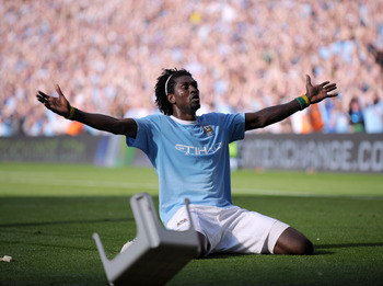 "Adebayor celebrates in front of the traveling Arsenal fans, and gets ""stooled"" as a result"