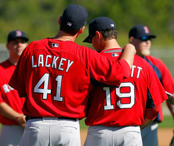 FORT MYERS, FL - FEBRUARY 19:  Pitchers John Lackey #41 and Josh Beckett #19 of the Boston Red Sox talk during a Spring Training Workout Session at the Red Sox Player Development Complex on February 19, 2011 in Fort Myers, Florida.  (Photo by J. Meric/Get